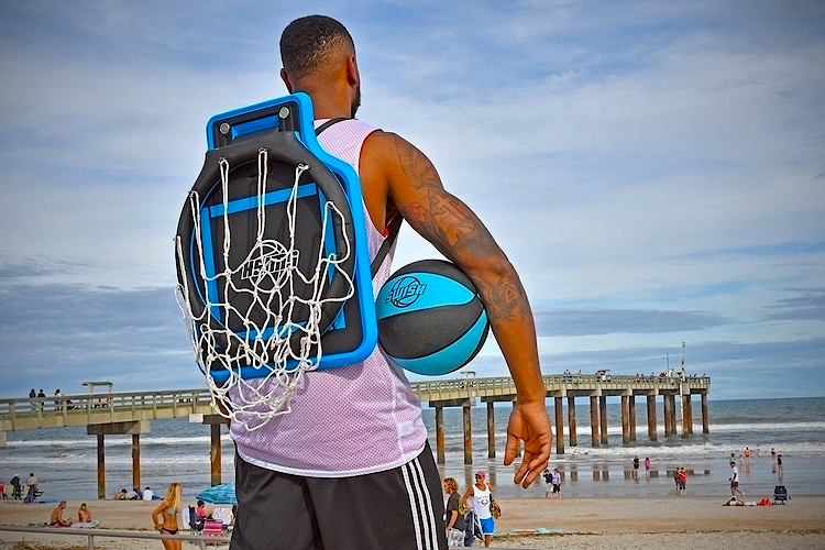 Swish Portable Basketball Hoop worn as a backpack at the beach